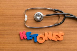 ketones colorful word with Stethoscope on wooden background