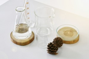Group of laboratory glassware with natural ingredient for beauty products.