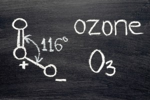name, chemical formula and structure diagram of Ozone handwritten on blackboard