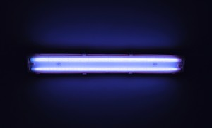 Detail shot of a fluorescent light tube on a wall with copyspace.